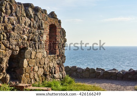 Part of a boulder wall at Hammershus ancient castle ruin on bornholm, denmark, with the Baltic Sea in the background - stock photo