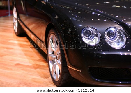 Part of a car. Focus on the headlamps. - stock photo