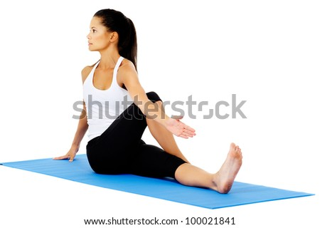 Part of a collection of yoga poses by a fit active hispanic woman; half spinal twist - stock photo