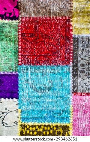 Part of a colorful  patchwork textile as a background - stock photo