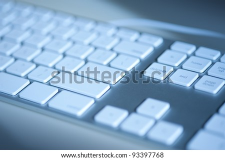 Part of a computer keyboard in blues - stock photo