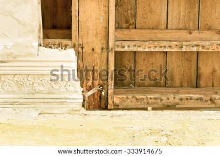 Part of a damaged interior ceiling with exposed timber - stock photo