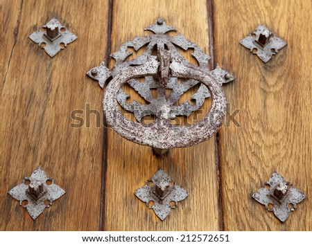 Part of a door of old castle. Wood and metal. Medieval architecture  - stock photo