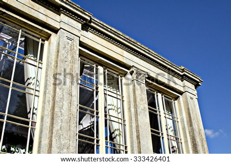 Part of a georgian building in the UK with tall windows - stock photo