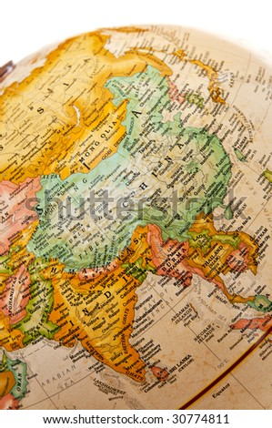 Part of a globe with map of Asia - stock photo
