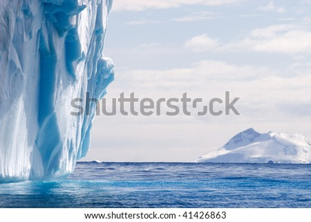 part of a large dripping iceberg - stock photo