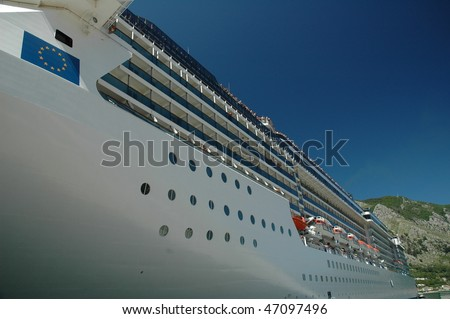 Part Of A Large White Cruise Ship, Cabins, Rescue Boats, Deck - stock photo