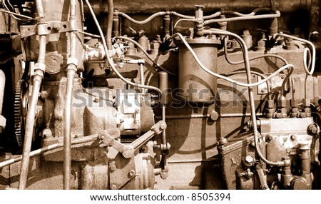 Part of a old car engine. - stock photo