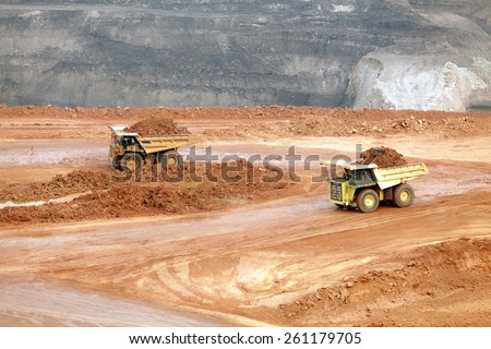 Part of a pit with big mining truck working - stock photo