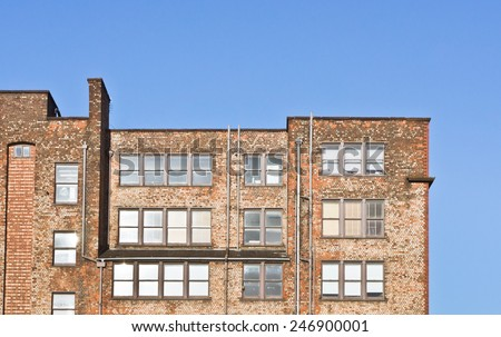 Part of a red brick industrial warehouse building in Manchester, UK - stock photo