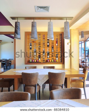 Part of a restaurant interior, drinks and lamps as decoration. - stock photo