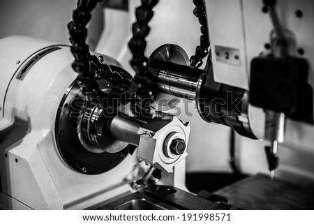 Part of a steel cutter machine in factory - stock photo
