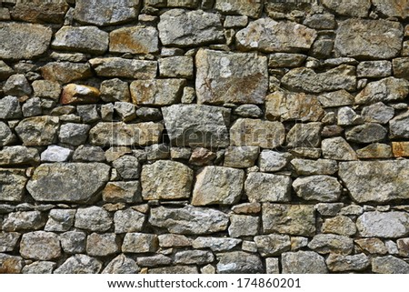 part of a stone wall with lot of rocks, made for texture