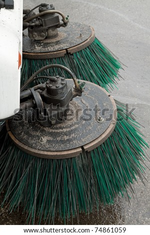 part of a street cleaning vehicle - stock photo