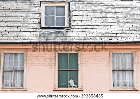 Part of a town house with an attic room - stock photo