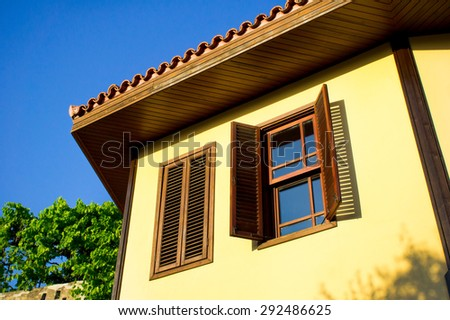 Part of a tradiitonal Ottoman house in Turkey, with wooden window shutters - stock photo