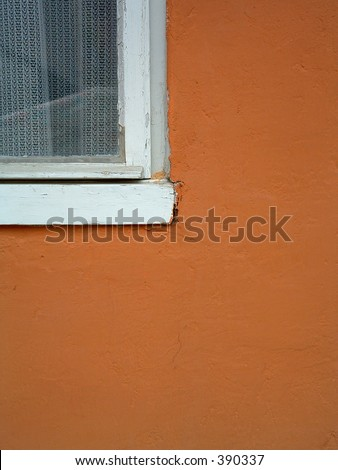 part of a window and orange wall - stock photo