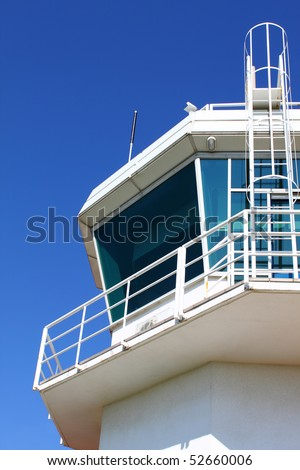 Part of aerodrome control tower with ladder, against clear sky - stock photo