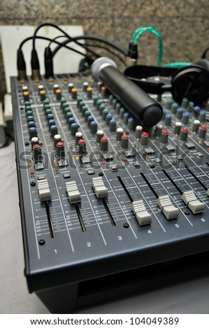 Part of an audio sound mixer - stock photo