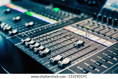 Part of an audio sound mixer with buttons and sliders . A little of DOF. - stock photo