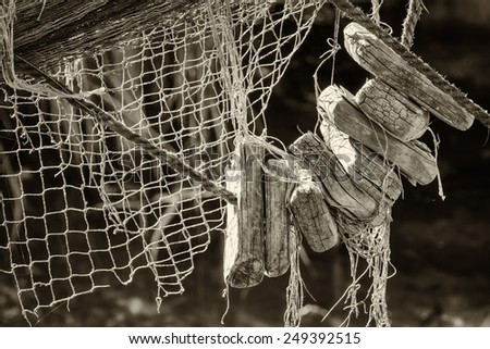part of an old fishing net - stock photo