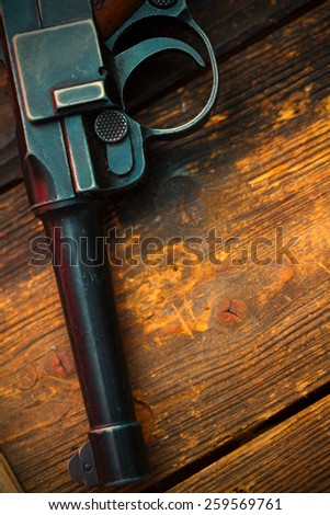 part of an old Luger pistol. Parabellum close up. Instagram image retro style - stock photo