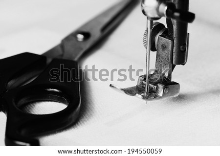 Part of an old sewing machine.Detail on needle.Black and white picture. - stock photo