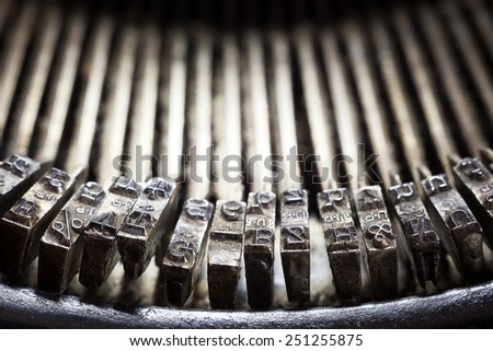 Part of an old typewriter, closeup of printing letters.  - stock photo