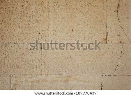 Part of ancient greek writings on stone, Crete, Greece - stock photo