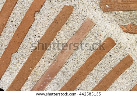 Part of arc of orange bricks and mortar. - stock photo