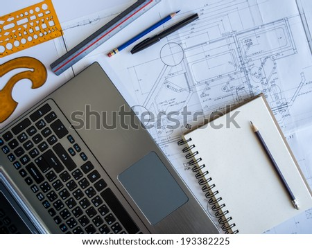 Part of architectural Blueprint with tools and laptop on the table - stock photo