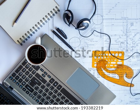 Part of architectural Blueprint with tools / coffee and laptop on the table - stock photo