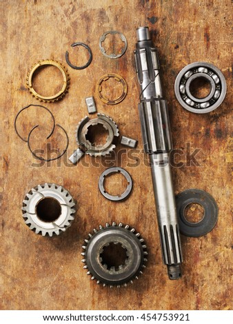 Part of auto transmission gear on the wooden work table. Top view. - stock photo