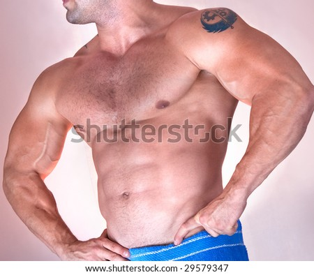 Part of beautiful male torso. Isolated on pink. Side view