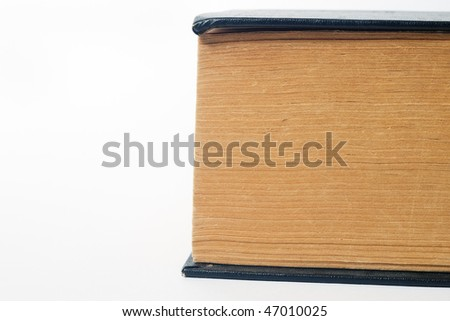 Part of big old book with yellow pages with copy space and selective focus - stock photo