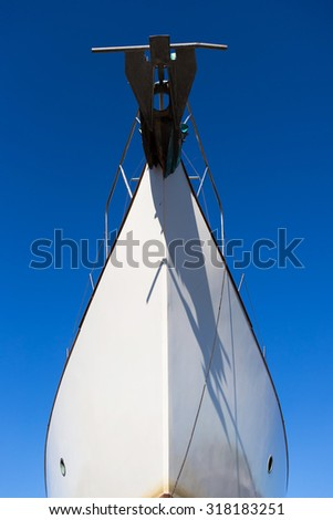 Part of big white ship moored in port. Port in Jastarnia, Poland. - stock photo