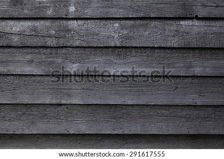 part of black wooden fence or part of black painted barn - stock photo