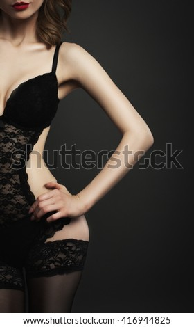 Part of body woman in black lingerie studio shot - stock photo