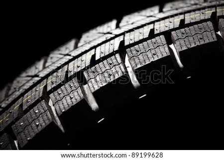 Part of brand new car tyre close-up. Horizontal composition. - stock photo