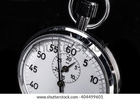 Part of chronometer isolated on black background - stock photo