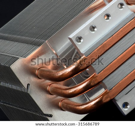 Part of cooling system with copper pipes. Computer, industry and technology concept. - stock photo