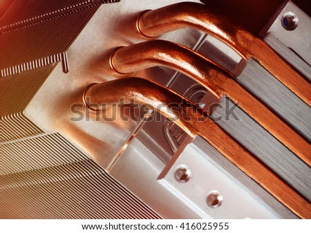 Part of cooling system with copper pipes. Computer, industry and technology concept. Toned image. - stock photo