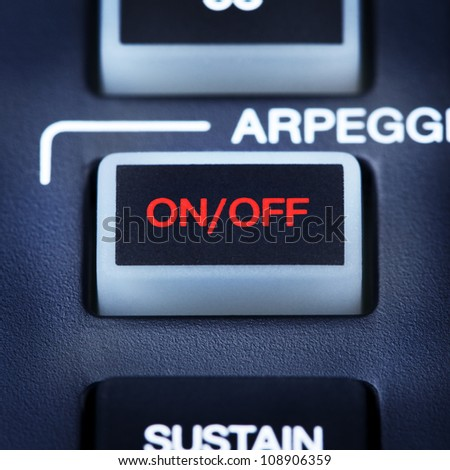 part of digital midi keyboard, on/off button - stock photo