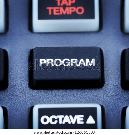 part of digital midi keyboard, program button - stock photo