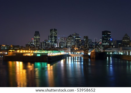 Part of Downtown Montreal at Night and Color Harbour Reflection in the water
