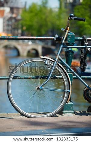 Part of dutch bike parked on a bridge in Amsterdam, Netherlands - stock photo