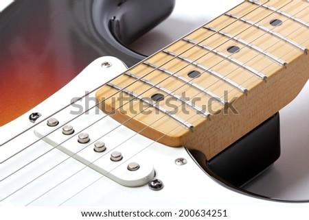 Part of electric guitar close-up, studio shot - stock photo