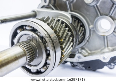 part of engine gearbox on isolated background - stock photo
