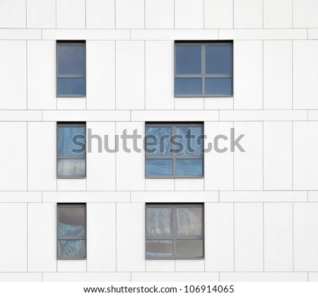 Part of exterior under construction with covered windows - stock photo