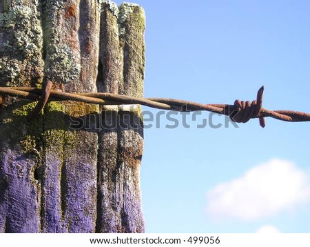 part of farm fence - stock photo